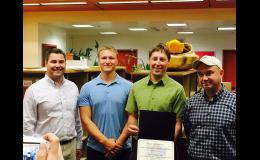PARTNER IN EDUCATION— NSEDC Chief Operating Officer Tyler Rhodes, along with EET Director Jesse Blandford and Nome NSEDC board representative Pat Johanson, accepts the Nome School Board's Partner in Education award from Superintendent Shawn Arnold. NSEDC recently contributed $60,000 to the schools for new student computers.