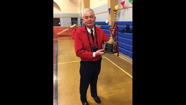 50 YEARS— Chuck Fagerstrom was awarded with a golden bugle commemorative award for having served the Nome Volunteer Fire Department for half a century during last Saturday's Firemen's Carnival.