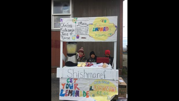 LEMONADE DAY SHISHMAREF— Katesonja, Tyrese and Jace Ivanoff set up  their lemonade stand outside of the community hall in Shishmaref during last Saturday's Lemonade Day. Kids in Nome and the region practiced their business skills as they sold ice cold lemonade, baked goods and other delicacies to folks in their communities
