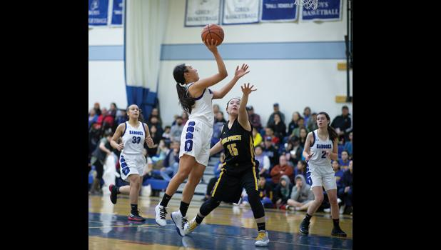 TWO MORE – Lady Nanook Brooke Anungazuk, center, gets two against Unalakleet Thursday in the Subway Showdown tournament.