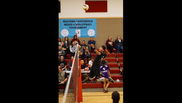 MIXED SIX— Unalakleet's Arctic Ivanoff rises high for a spike in championship match in the Western Conference Mixed 6 tournament held in St. Michael last week.