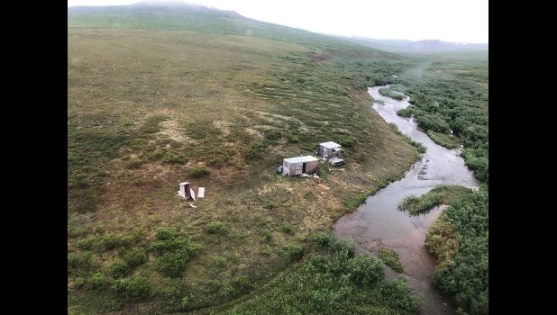 """CAMP— Jessee's camp at the Big Four Creek, where he was attacked by the bear. Jessee wrote on the roof of the rectangular cabin the words """"SOS Help Me."""" The Coast Guard pilots saw the man waving with both hands, turned the helicopter around and picked the man up to bring him to safety in Nome."""
