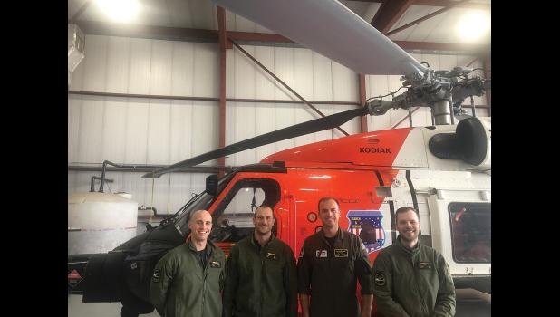 TO THE RESCUE—  U.S. Coast Guard airmen saved miner Richard Jessee after he had been attacked and stalked by a bear for several days. The air crew was (left to right) LTJG AJ Hammac, AST 1 Adam Carr, LCDR pilot Jared Carbajal, and AET2 Jeremy Reed.