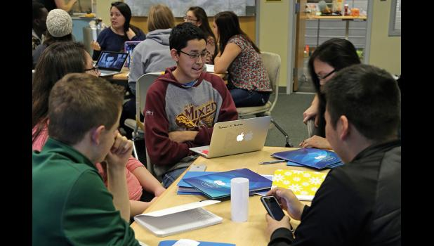 TEAMWORK– Samuel Tocktoo of Shishmaref works with his fellow Arctic Youth Ambassadors.