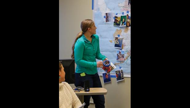 ON THE MAP– Nome's Jannelle Trowbridge places her picture on a map of Alaska. The 22 ambassadors came from 16 communities around Alaska.