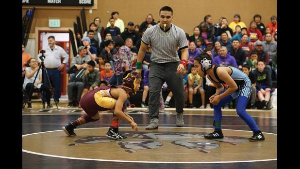 BSSD WRESTLING AND CHEERLEADER TOURNAMENT— Ricky Paniptchuk of Shaktoolik, left, gets ready to wrestle Cody Aningayou of Gambell in the Elementary Snipe Division during last week's BSSD 36th annual Wrestling and Cheerleading tourney held in Unalakleet.