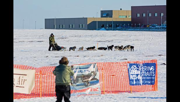 WINNER— Kotzebue musher Paul Hansen approaches the finish line on Sunday evening, winning the 2016 Nome-Council sled dog race in a time of 32 hours and six minutes.