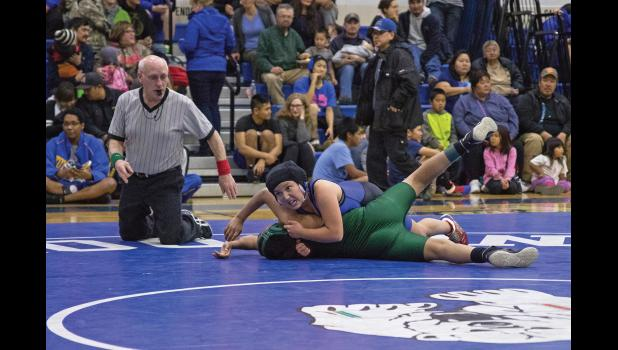 WRESTLE LIKE A GIRL— Nanook middle schooler Katie Smith beat four boys en route to a first place finish in her weight division at the Nome Invite last weekend.