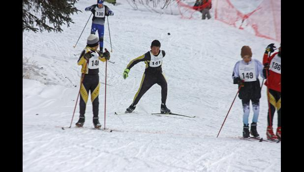 KING OF BIATHLON— Ben Homekingkeo of Koyuk comes around for his second lap in the junior high boys race at the BSSD Ski and Biathlon Championships in White Mountain last weekend. Homekingkeo hit all targets and won the gold medal in the event.