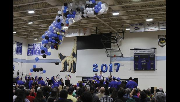 SCHOOL'S OUT— Graduates of the Nome-Beltz Class of 2017 celebrate completing high school as ballons are released at the end of their graduation ceremony on May 25.
