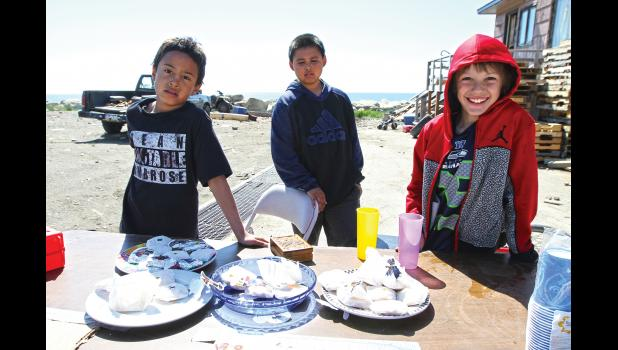 LEMONADE DAY— Phoenix Hall, Shane Ozenna and Jacob Heers offered a variety of cookies along with lemonade at their Front Street location in Nome.