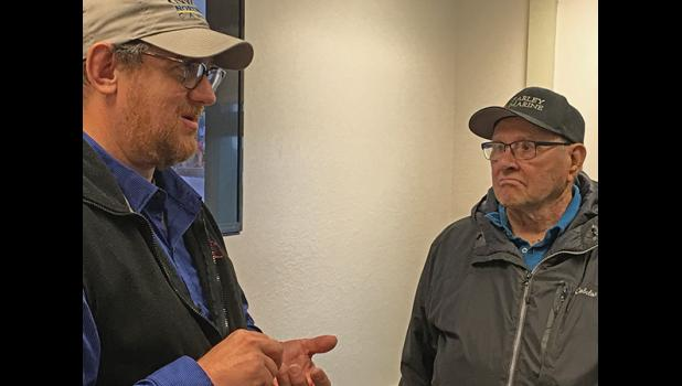 Howard Farley Sr. talks Pacific cod appearing in his crab pots in increasing numbers with research scientist Lyle Britt at an Aug. 2 Strait Science session. Farley has decades of experience in several Bering Sea fisheries. His son Harvey has been crabbing since 2001. The family business keeps records scientists find valuable.