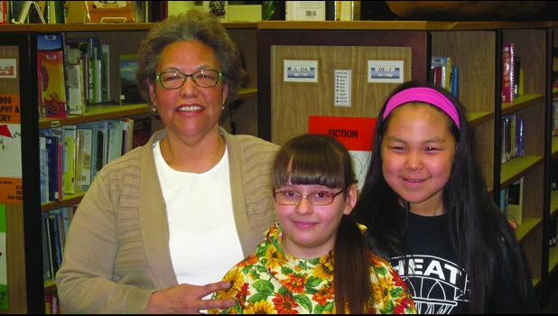 "ART—Alaska Native Culture teacher Josie Bourdon worked with students Iryna Kadustka and Kaitlyn Moses on their art projects, ""Many Lands, One Arctic."" The videos the girls made are on display at the Art Center in Juneau."