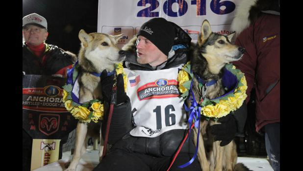 CHAMPION— Dallas Seavey, 29, of Willow, Alaska, claimed his fourth Iditarod title when he arrived in record time on Tuesday morning at 2:20 a.m. under the burled arch in Nome.
