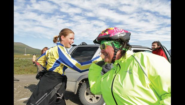 WYATT EARP DEXTER CHALLENGE— Jackie Hrabok-Leppäjärvi, right, highfives a runner crossing the finish line at last Saturday's Dexter running, biking and walking race from Nome to Dexter.