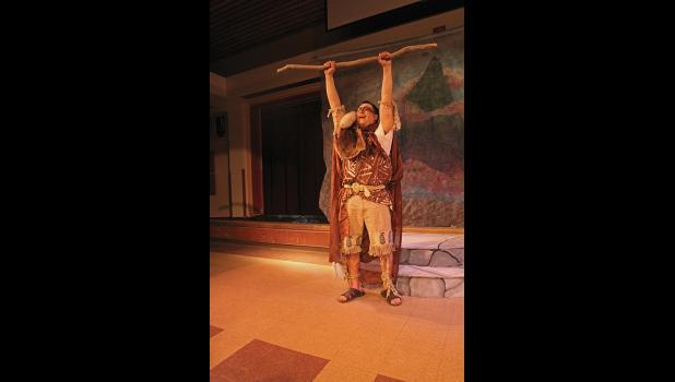 """SHAKESPEARE IN NOME— Caliban, played by Jake Kenick, breaks free from his bonds as a slave in a Nome Arts Council production of Shakespeare's """"The Tempest"""" last weekend."""