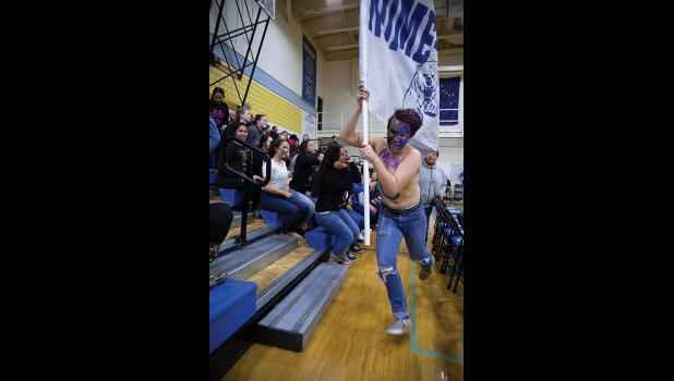 NANOOK FLAG – During a lull in the action courtside the Nanook Flag made a frenzied run around the gym.