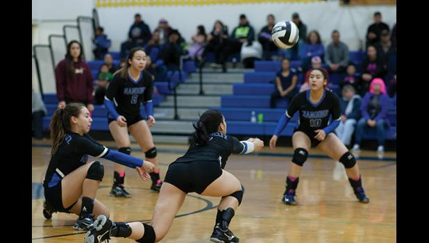 TEAM PLAY – The Lady Nanooks in action show good coordination.