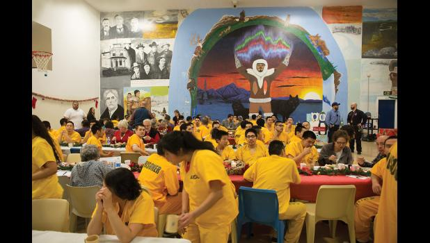 CHRISTMAS POTLATCH— The basketball court at Anvil Mountain Correctional Center doubles as a large dining hall during last week's potlatch.