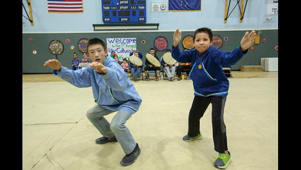 TELLER CULTURAL FESTIVAL— Shishmaref dancers Kenny Iyatunguk, left, and Gavin Nayokpuk entertain the crowd at last weekend's Teller Cultural Festival. See story and photos on pages 8/9.