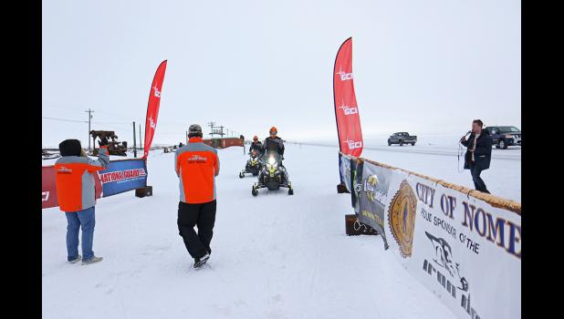 FIRST INTO NOME— Tyler Aklestad and Tyson Johnson arrived in Nome, the halfway point of the Iron Dog Snowmachine race on Tuesday at 3:34 p.m.