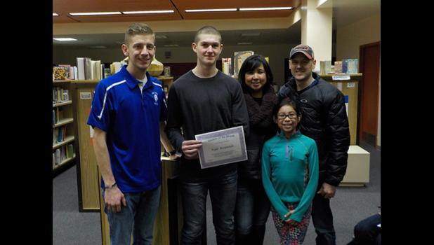NBHS STUDENT OF THE MONTH—  Kyle Reynolds is Nome-Beltz Sr. High School's October Student of the Month. He is pictured here with NBHS Assistant Principal Lucas Frost and his family