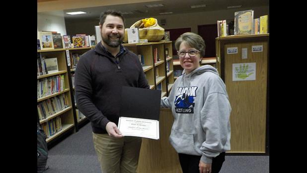 TEACHER OF THE MONTH— Kim Erikson, Nome Elementary School Second Grade Teacher, is the October Teacher of the Month. She is pictured with Superintendent Shawn Arnold.