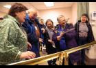 BIG SCISSORS – NSHC board member Alice Fitka wields the big scissors to cut the ceremonial ribbon at the dedication of the hospital's new MRI machine. From left are Berda Willson, Native Village of Council; Alfred Sahlin of Nome Eskimo Community; Jean Ferris of Stebbins; Alice Fitka of St. Michael and Mathilda Hardy, Native Village of Shaktoolik.