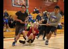 NYO WRIST CARRY— Paris Hebel hangs on while Nate Cushman, left, and Elden Cross run him around the perimeter of the gym in the Wrist Carry event during last weekend's NYO Extravaganza in Nome.