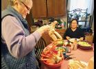 During Iditarod time, Nancy McGuire opened her home and kitchen to countless visitors who would get the royal treatment of a king crab meal.